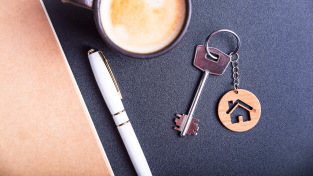 House key and cup of tea on a table illustrating property owners liability cover